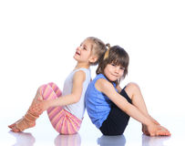 Kids practice yoga. Cute little boy and girl practice yoga. Isolated on the white background Stock Photo