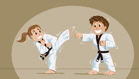 Kids practicing martial arts. Two kids sparring or training together Royalty Free Stock Image