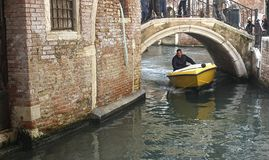 Kids in Prague. This photo was taken in Venice, Italy. Guy rides motorboat Royalty Free Stock Photography
