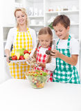Kids preparing a healthy fresh salad Stock Image