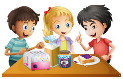 Kids preparing their snacks Stock Image