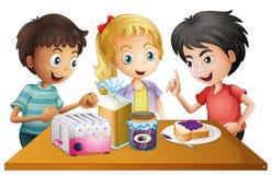 Kids preparing their snacks Stock Image