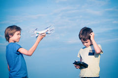 Kids preparing to fly drone outdoors. stock image