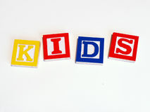 Kids preschool blocks. Childrens' blocks spelling KIDS royalty free stock images