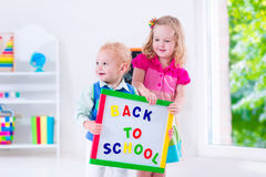 Kids at preschool painting. Kids at preschool. Two children drawing and painting at kindergarten. Boy and girl happy to go back to school. Toddler kid and baby stock images