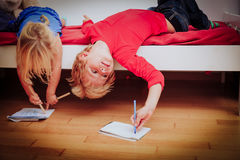 Kids pretend doing homework royalty free stock photo
