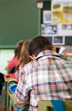 Kids in a primary school classroom Stock Image