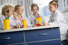 Kids in protective glasses making experiment Stock Photography