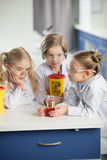 Kids in protective glasses making experiment Royalty Free Stock Photos