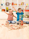 Kids proud of their wooden block buildings Stock Image