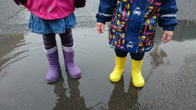 Kids in the puddle Royalty Free Stock Photo