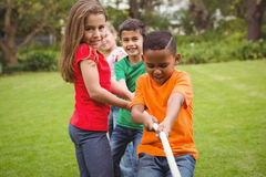Kids pulling a large rope. Together Stock Photo