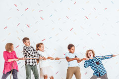 Kids pulling a rope. Group of happy kids pulling a rope Royalty Free Stock Photography