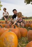 Kids and Pumpkins Royalty Free Stock Images
