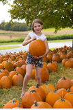 Kids and Pumpkins stock photo