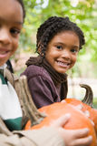 Kids with pumpkins stock images