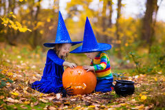 Kids with pumpkins on Halloween Stock Image