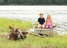 Kids in punt. Little kids - girl in and boy sitting in the punt Royalty Free Stock Photos