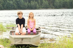 Kids in punt. Little kids - girl in and boy sitting in the punt Stock Photography