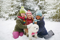 Kids with puppy Stock Images