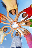 Kids put arms with claws straight in star shape Royalty Free Stock Photography