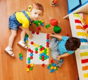 Kids and puzzle Royalty Free Stock Images