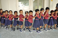 Kids que. Montessori kids walk in que stock images