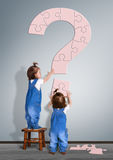 Kids question concept. Little childrens made question mark from royalty free stock image