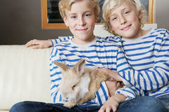 Kids with Rabbit at Home Stock Images