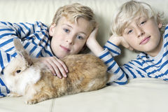 Kids with Rabbit at Home Royalty Free Stock Image