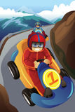Kids racing in a go-kart. A vector illustration of kids racing in a go-kart like car in the mountain road Royalty Free Stock Photography