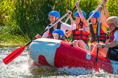 Kids and rafting. A popular place for extreme family recreation and training of athletes in rafting and kayaking. royalty free stock photography