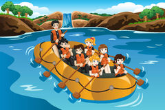 Kids rafting in a river Stock Image