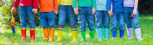 Kids in rain boots. Rubber boots for children. royalty free stock photos