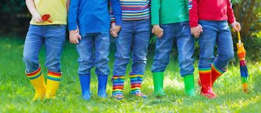 Kids in rain boots. Rubber boots for children. Stock Photo