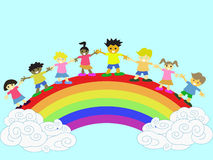 Kids on the rainbow Stock Photography