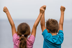 Kids with raised arms. Young caucasian kids in Denmark on a summer day Stock Photos