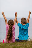 Kids with raised arms. Young caucasian kids in Denmark on a summer day Stock Images