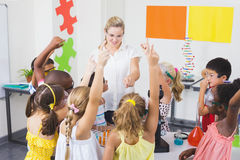 Kids raising hand in laboratory Stock Image