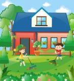 Kids raking leaves at home Royalty Free Stock Images
