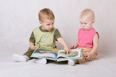Kids read the book stock photos