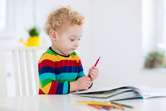 Kids read, write and paint. Child doing homework. Royalty Free Stock Photo