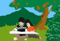 Kids reading. A girl and boy sitting the garden reading books Stock Photo