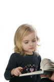 Kids reading. Older sister reads book to younger one Royalty Free Stock Photo