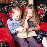Kids reading book at home Royalty Free Stock Photo