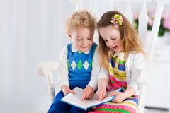 Kids reading a book Stock Image