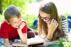 Kids reading a book stock photo
