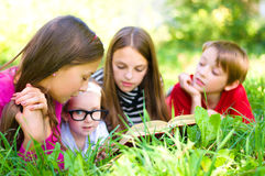 Kids reading a book royalty free stock image