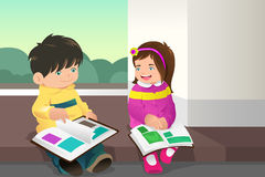 Kids reading a book. A vector illustration of two kids reading a book together Stock Photos