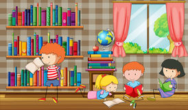 Kids reading books in the library Royalty Free Stock Image